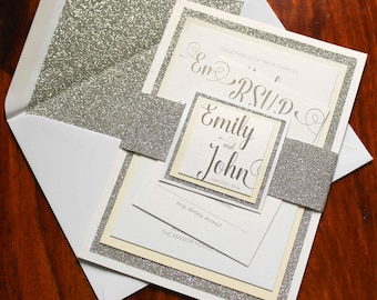 Silver glitter and ivory pearlescent invitation packages