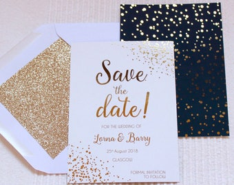 Luxury gold foil on silk white and navy wedding save the date or evening cards with glitter lined white envelopes