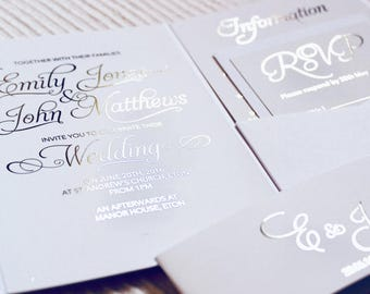 Elegant white and gold foil pocketfold wedding invitations with white envelopes and gold glitter lining