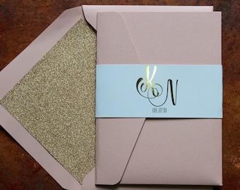 Elegant blush pink, white and gold foil pocketfold wedding invitations with glitter lined blush envelopes