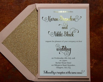 Luxury gold and blush pink day or evening invitations with glitter lined envelopes.