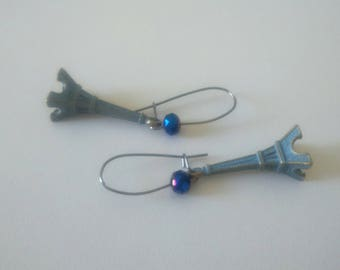 Beautiful dangling earrings. Collection eiffel tower bronze and dark blue glossy