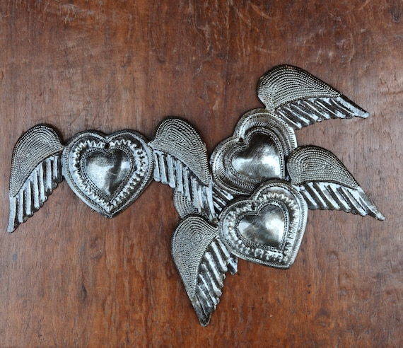"Hearts with Wings, Flying hearts, (Set of 3) Each with a slightly different center design, made from Recycled Metal Barrels,Haiti 6"" x 3"""