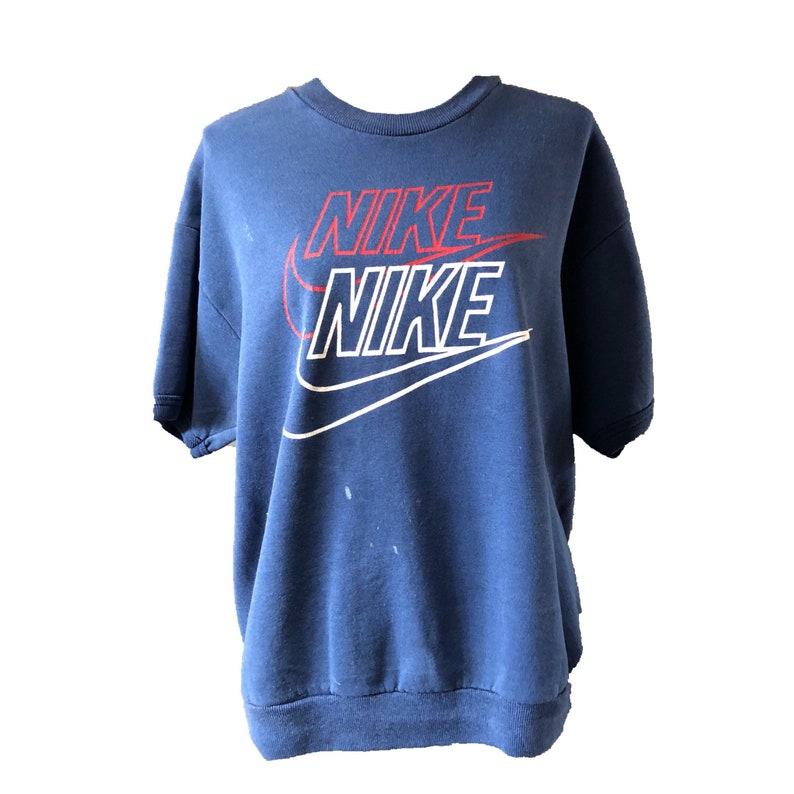 678afbf195ca Vtg Nike Sweater Red white blue short sleeve vintage mens | Etsy