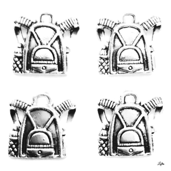 6 Backpack charms antique silver tone CA48