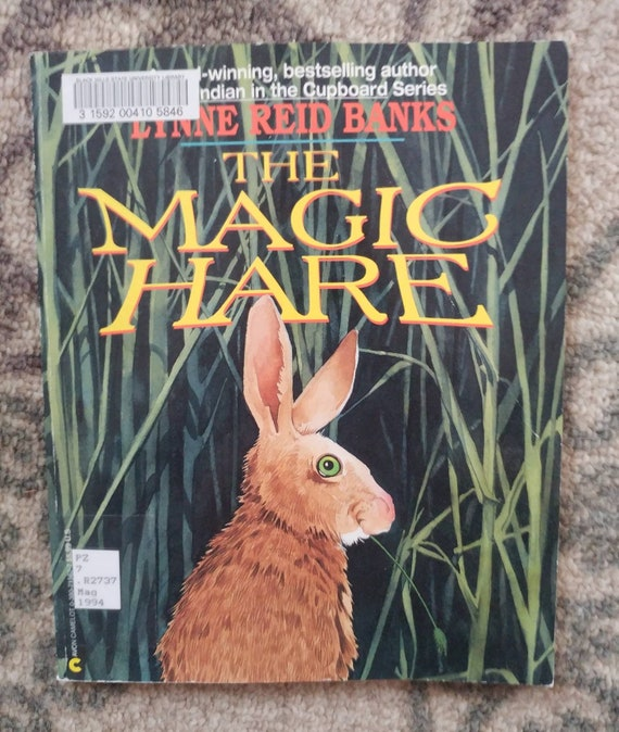 FREE SHIPPING The Magic Hare by Lynne Reid Banks // Discarded Library Books // Used Fair Condition // Marks on Cover // Sold As Is //