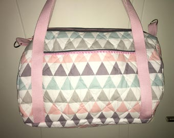 Personalized triangle pattern quilted fabric diaper bag.