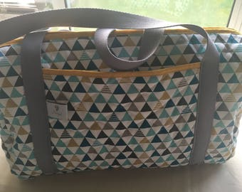 Changing bag in quilted fabric.