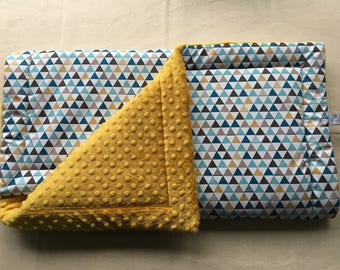 Plaid baby blanket with graphic pattern.