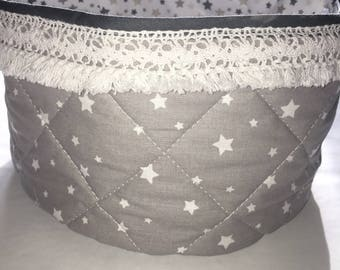 Fabric with lace crochet basket.