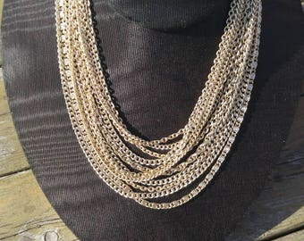 Multistrand chain necklace signed Coro.  Elegant 1960s gold tone glamour jewelry.