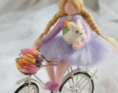Baby girl cycling with tippete, wool doll fairy tale, Waldorf inspiration, house decor