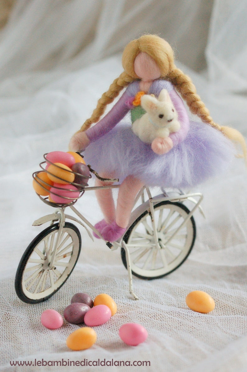 Baby girl cycling with tippete wool doll fairy tale Waldorf image 0