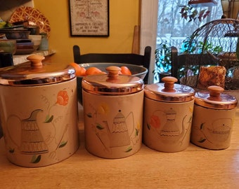 Retro Ransburg Indianapolis canister set with copper tone lids, metal, wood knobs