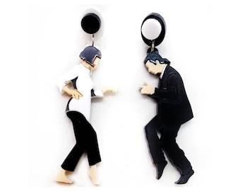 Asymmetrical pendant earrings Pulp Fiction film cinema splatter dance black and white plexiglass laser cut