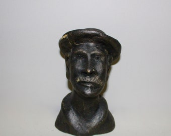 Cast sculpture of an old man