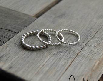 Beautifull ring - stack ring - made from globules in silver and gold