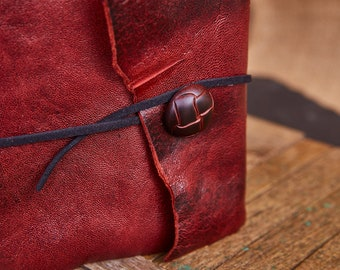 Dark Red Leather Wrap with red and black button and black suede strap, Medium Book 112 blank pages