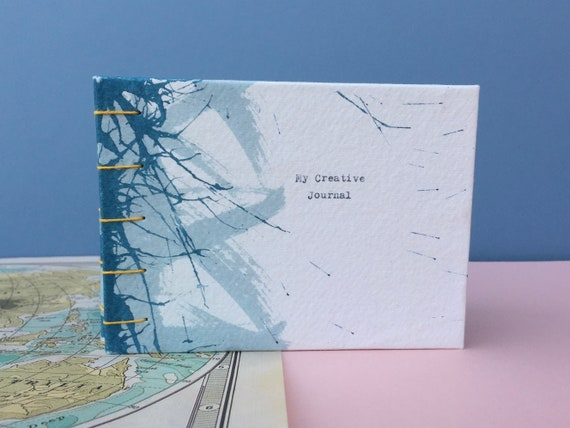 personalised eco friendly sketchbook, hand painted and hand bound.