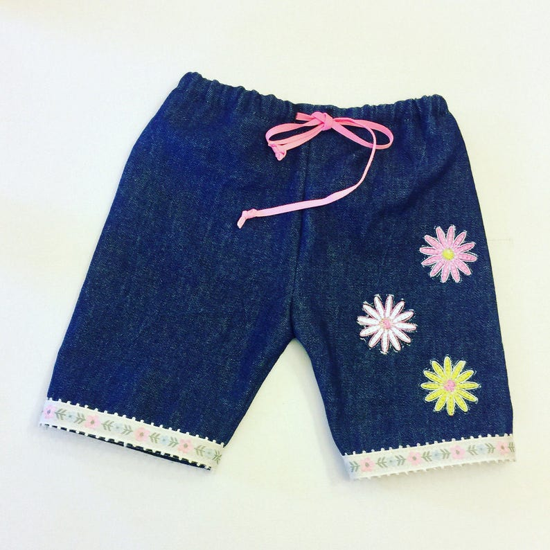 c585fbe0a Baby Girl Denim Pants with flowers embroidery and flower Trim