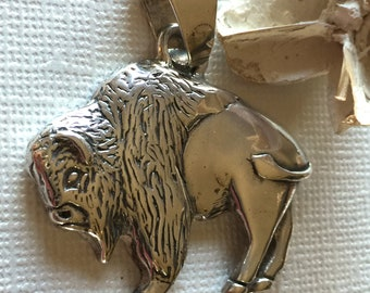 American Buffal Bison Pendant on Black Cord. Sterling Silver. Stamped GS.