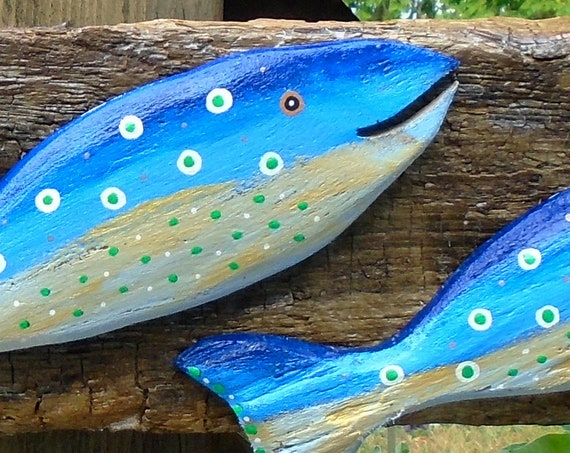 3 happy leaping fish on driftwood