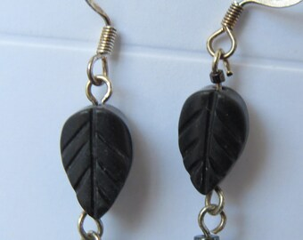 Carved black stone leaves with long hematite and black stone bead earrings in silver