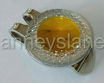 Anneys Golf ball marker - 20mm diameter + hat clip - rhinstone clear/ yellow