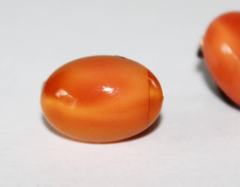 Vintage Orange Glass Earrings Clip Ons 1930s Glow Oval Cats Eye Pattern