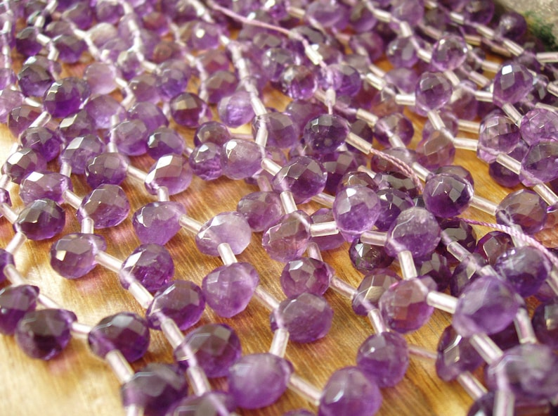 sku#279 Faceted Teardrop Briolette 8x9x12mm A Quality 34 pieces per strand 17 pieces half strand Special Find by Energy Stone