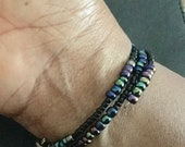 7/11 bead, black rainbow ...