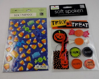 Halloween sticker embellishments with pumpkins, wrapped candy, candy corn and trick or treat banner for scrapbooking.