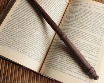 Magic wand made of walnut - present