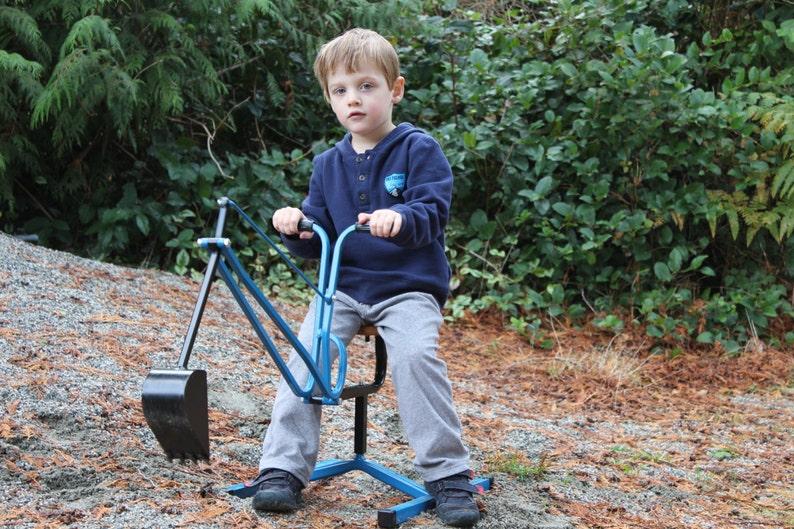 Ride on sandbox digger