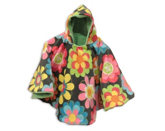 cd5c5c2704537 Colorful Flowers Car Seat Poncho fits 6 months to 4 years. It s Reversible