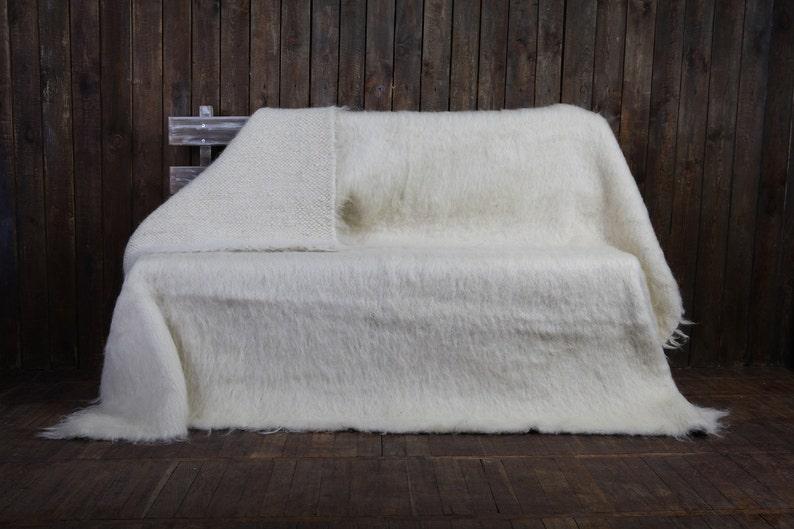 White handmade wool throw.