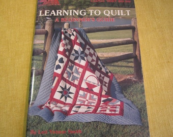 Learning To Quilt, A Beginner's Guide, by Lori Yetmar Smith,Leisure Arts, 25 lessons, 20 block patterns,general instructions on making quilt