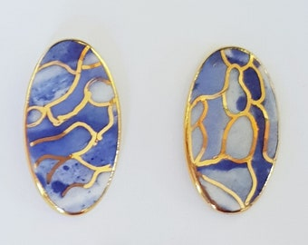 Elegant oval shaped porcelain studs with gold or platinum