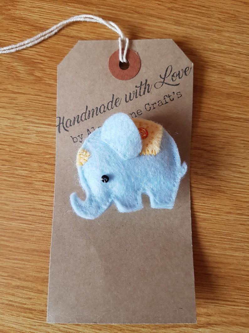 Felt elephant brooch in blue with yellow