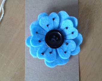 Felt flower brooch in pale blue