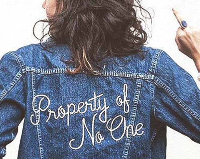"Featured listing image: ""Property of No One"" Hand Embroidered Denim Jacket"