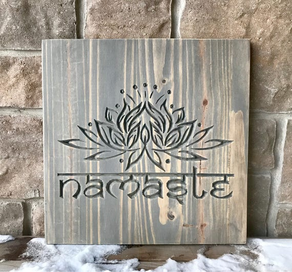Carved wood wall hanging, Namaste