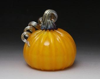 Yellowish Opal Orange Hand Blown Glass Pumpkin with an iridescent gold stem