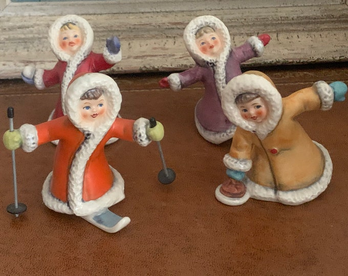 Four German Goebel Hummel Children Winter Figurines 11701, 11702, 11703, 11704