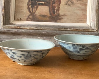 Two Chinese Ming Dynasty (1368-1644 A.D) pale blue glazed porcelain bowls with hand painted decoration