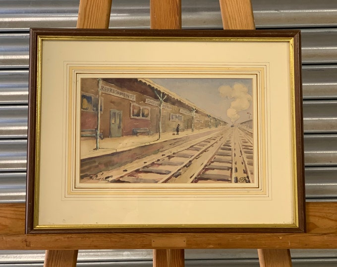This is a lovely original vintage watercolour titled 'The Last Train' signed by the artist lower right with the initials H B