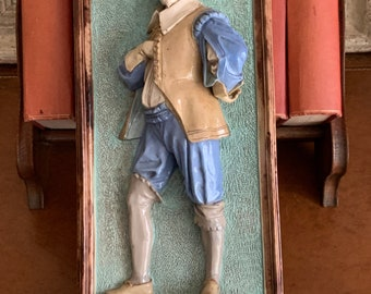 Wayte & Ridge, of Longton, Staffordshire Figural plaque, circa 1870, modelled as a 17th century Shakespearean style gentleman