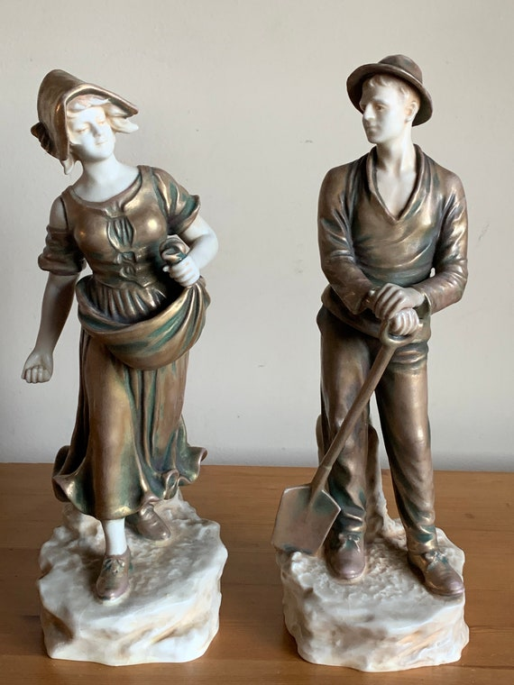Rare Pair of Late 19th/early 20th Century Ceramic Figurines by Theodore Schoop for Bernard Bloch Titled 'Farming Couple'