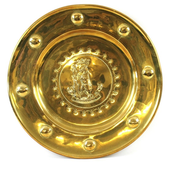 An Antique 19th Century Brass Charger With The Warwick Coat Of Arms