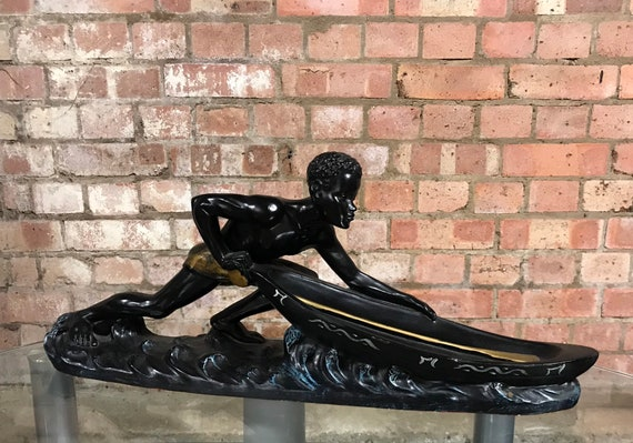Fabulous Vintage Ceramic Sculpture Of An African Blackamoor Style Figurine Pushing a Boat Out, By D'Ambrosio